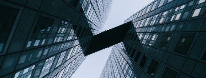 Fuzje i przejęcia banków – co powinni wiedzieć klienci?